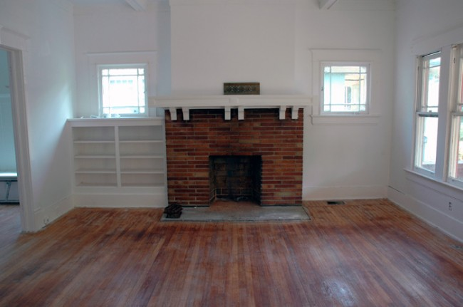 Fire place and built-in bookshelf.