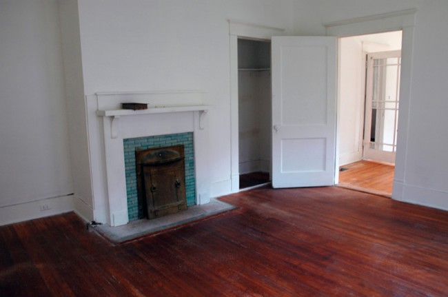 Coal fire place, closet and door to office/front bedroom.
