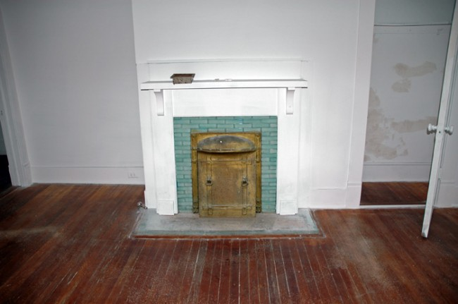 Beautifully colored coal fire place tile.
