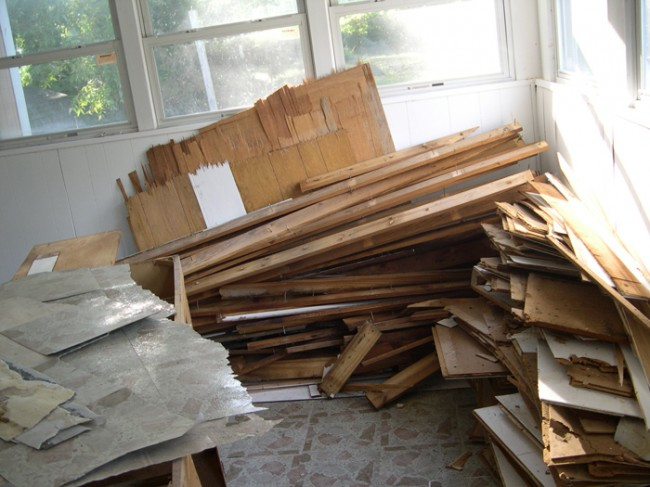 The pile of demolition stuff (pre-dumpster) stored in the laundry room.