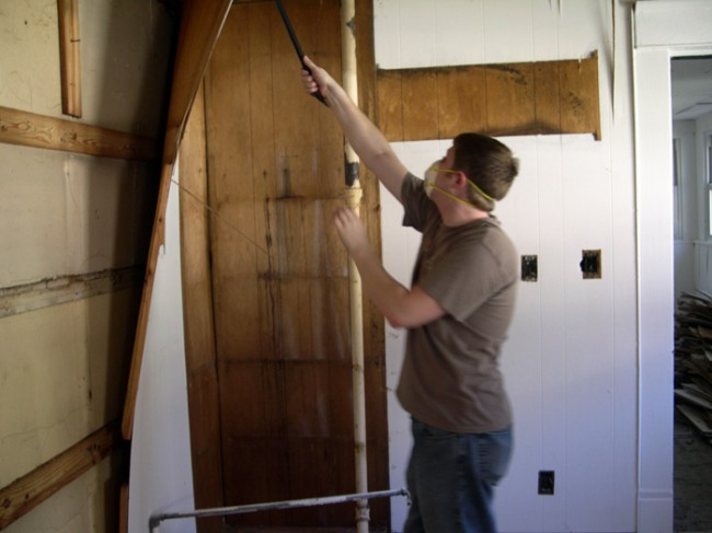 Removing the wood paneling.
