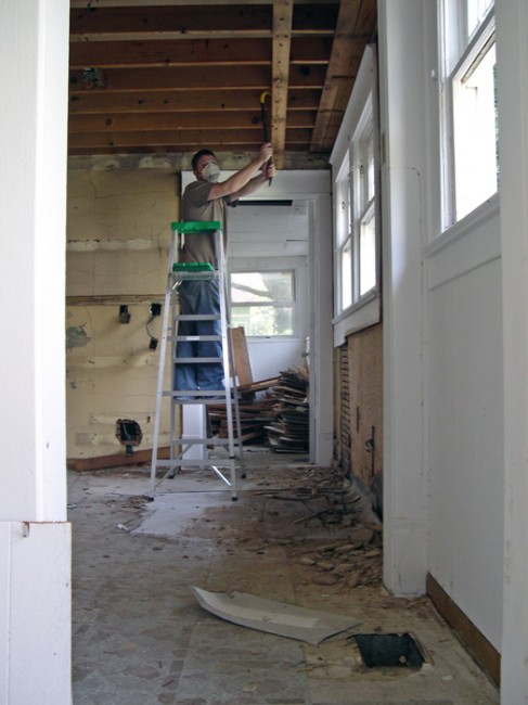 Half-way through removing the drop-ceiling beams...or so he thought...