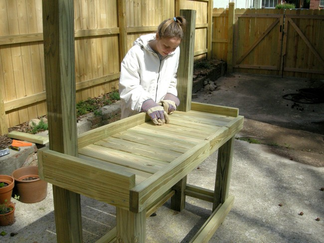 Steffi inserting the boards for the work surface.