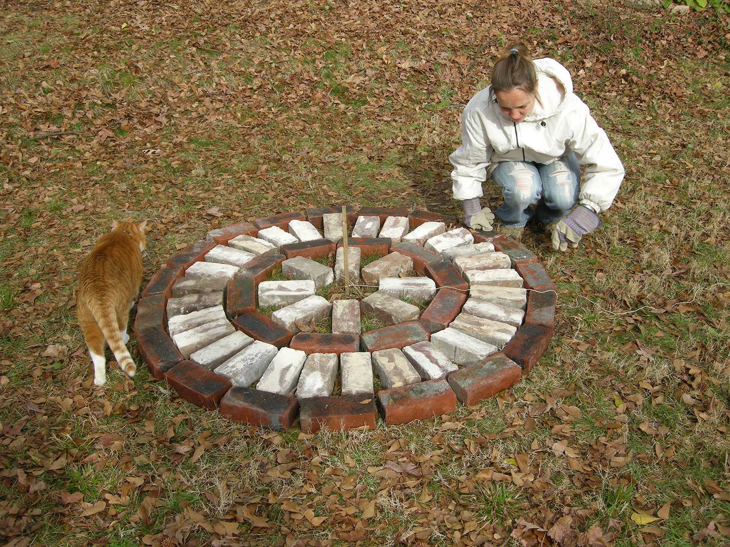 Steffi Laying Out The Bricks To Create The Pattern For The Patio.
