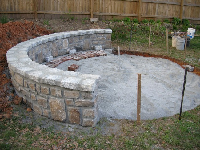 A ton of granite dust filled up the hole to create the foundation for the patio. Lots of strings and levels were used to make sure everything was nice and flat.